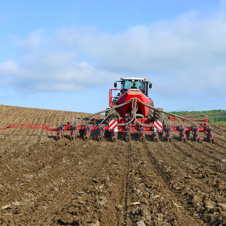 agricultural tenure: Planting corn trailed planter