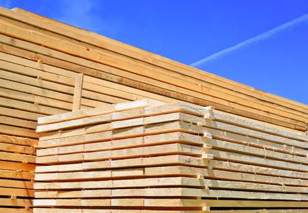 log deck: Eaves board in stacks.