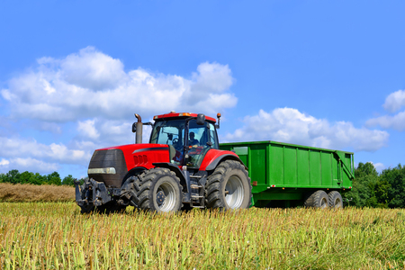 Modern tractor in a field Stock Photo
