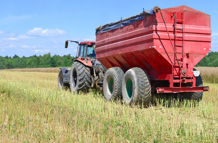 agricultural application tractor: Modern tractor in a field Stock Photo