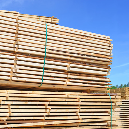 log deck: Eaves board in stacks Stock Photo