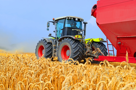 agricultural application tractor: Tractor with a tank for transporting grain