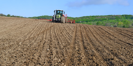 farm implement: Planting corn trailed planter in the field