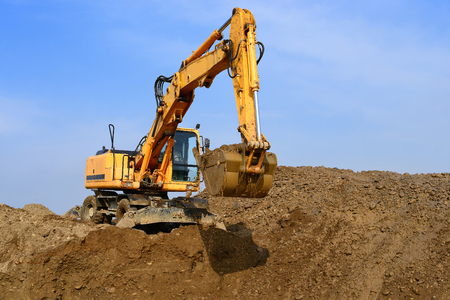 excavating machine: Dredge on a building site Stock Photo