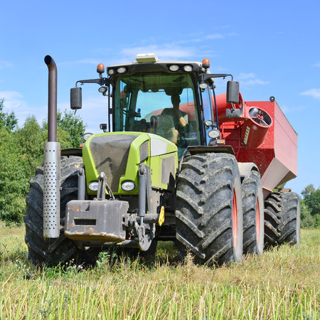 agricultural tenure: Modern tractor in a field Stock Photo