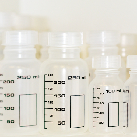 calibrated: Graduated plastic bottles for use in research laboratories