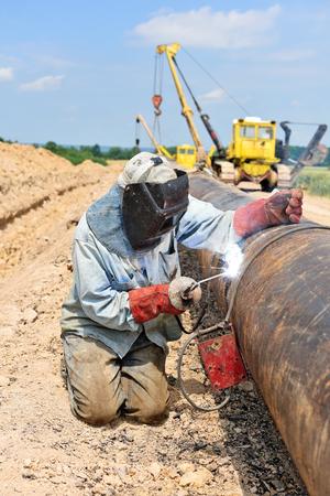 Welder on the pipeline repairs Stock Photo