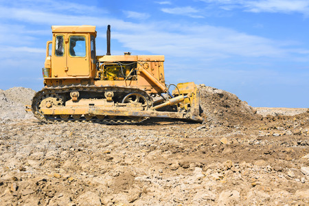 The bulldozer performs excavation work on the pipeline route.