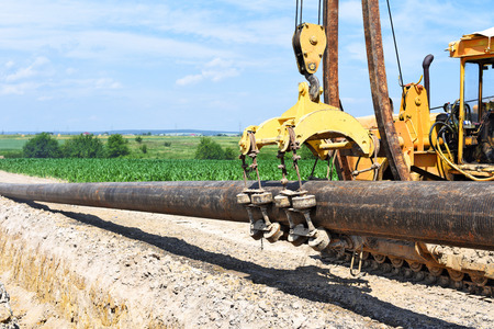 Repair of the pipeline. Cleaning of the surface of the pipe and the application of insulating material. Stock Photo