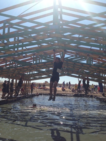 tough: Tough Mudder Challenge at the Sunshine Coast. Crazy obstacles including getting shocked by hanging wires while running and jumping over hay.