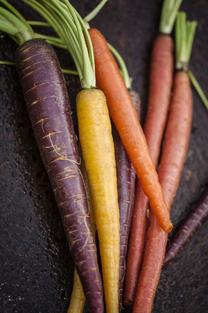 green and purple vegetables: Organic Rainbow Carrots Stock Photo