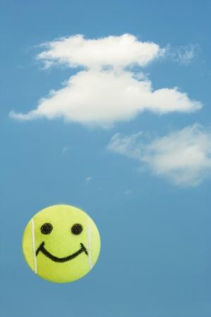 smiley: Tennis ball smiley face represents summer fun Stock Photo
