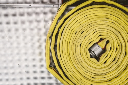 Coiled Yellow Fire Hose With Chrome Pattern Stock fotó - 20072173