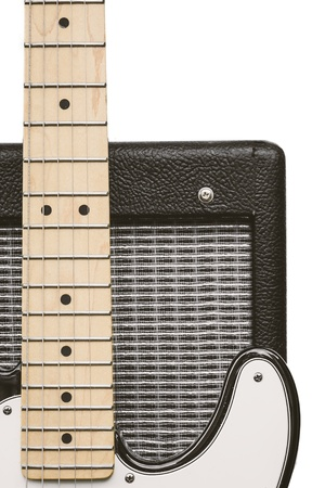 fretboard: Closeup of an electric guitar fretboard and a section of a guitar amplifier, isolated on a white background Stock Photo