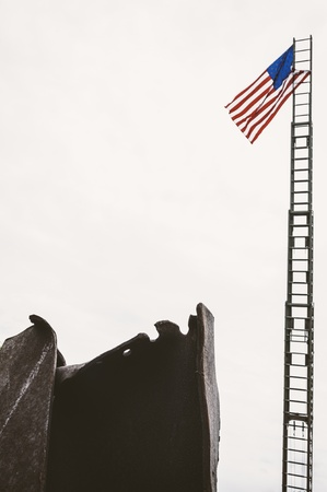 homage: Taken in Cincinnati, Ohio, this image shows an actual section of a support beam from the World Trade Center, after the terrorist attack on 911.  The wreckage was on display at a vintage fire fighting equipment event, as a tribute to the firefighters of N