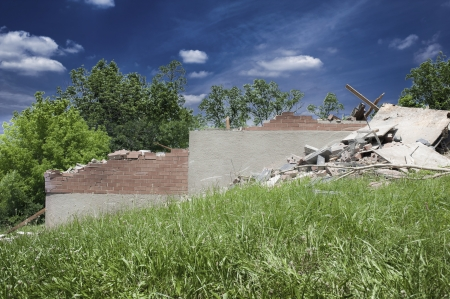 An existing structure is demolished on a future construction site