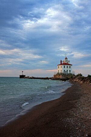 northeast ohio: Lighthouse and Watercolor Sky Stock Photo