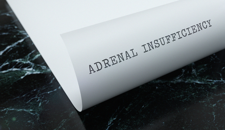 Adrenal Insufficiency written on paper with marble. Medicine concept. 3D Illustration.