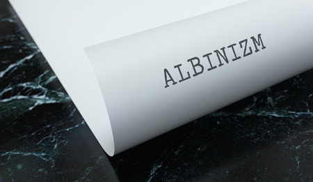 Albinism written on paper with marble. Medicine concept. 3D Illustration.