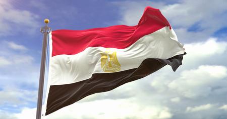 Egypt Flag Waving Wind On Sky Background. Wave And Fabric Egypt Flag. Фото со стока
