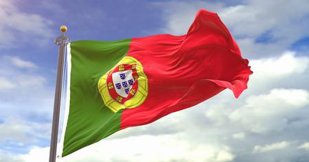 Portugal Flag On Sky Background. Wave And Fabric Portugal Flag. Фото со стока