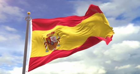 Spain Waving Wind On Sky Background. Wave And Fabric Spain Flag.