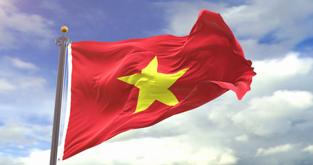 Vietnam Flag Waving Wind On Sky Background. Wave And Fabric Vietnam Flag.