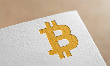 Golden Bitcoin Symbol Write Paper. Bitcoin Logo. Фото со стока