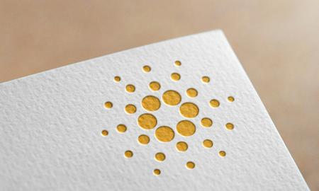 Golden Cardano Coin Symbol Write Paper. Cardano Coin Logo.