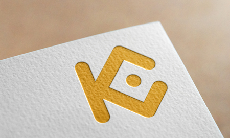 Golden Kucoin Symbol Write Paper. Kucoin Logo. Фото со стока