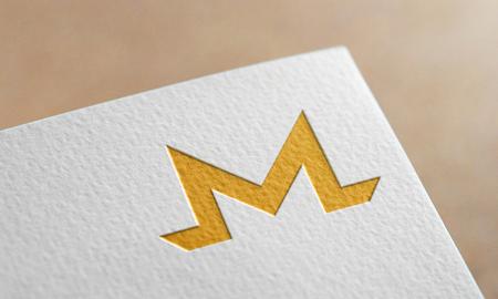 Golden Monero Coin Symbol Write Paper. Monero Coin Logo.