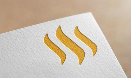 Golden Steem Coin Symbol Write Paper. Steem Coin Logo. Фото со стока