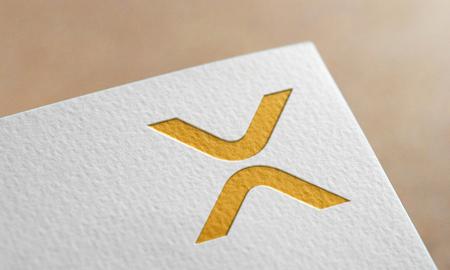 Golden XRP Coin Symbol Write Paper. XRP Coin Logo.