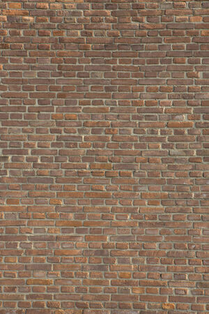 brick earth: usual brick wall of an old house, the vertical Stock Photo