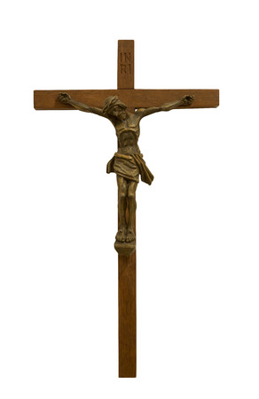 Crucifixion of Jesus Christ   Figurine on a brown wooden cross, isolated on white background photo