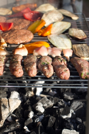 grill tongs sausage: Close of up food on an outdoor barbeque