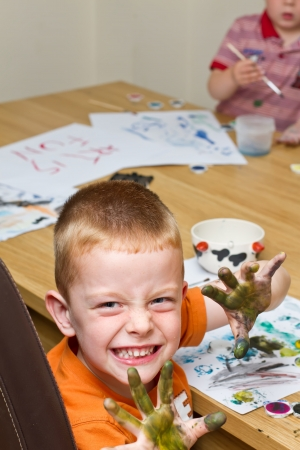 young boy painting a picture with a paintbrush Stock Photo - 14482048