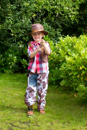 Young boy dressed up as a cowboy photo