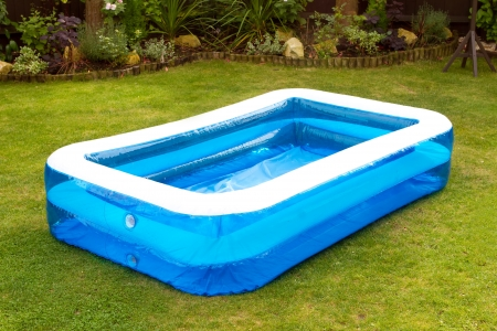 inflatable: an inflatable swimming pool in an english garden