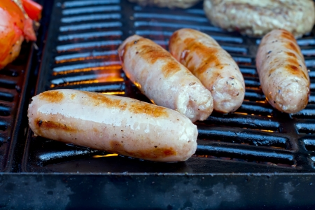 sausages slowly cooking on the barbecue Stock Photo - 15140717
