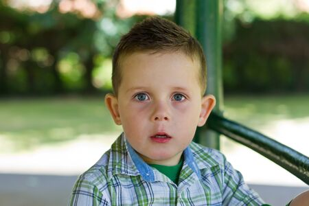 boy in the park looking out whilst thinking Stock Photo - 15945766