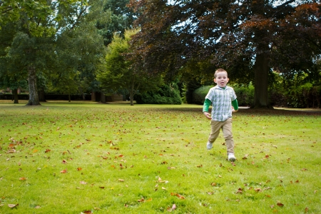 cute little boy running in the essex park Stock Photo - 15945781