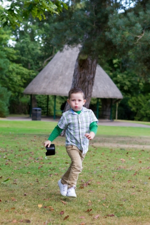 cute little boy running in the essex park Stock Photo - 15945776
