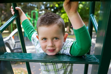 cute little boy playing on the slide Stock Photo - 15945764