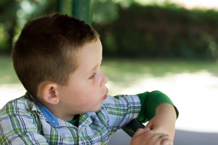 boy in the park looking out whilst thinking Stock Photo - 15945771
