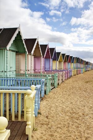 Row of colourful beach huts in rural essex photo