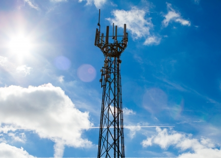 Mobile phone mast with a blue sky behind Stock Photo - 15696482