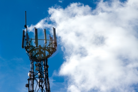 Mobile phone mast with a blue sky behind Stock Photo - 15696490