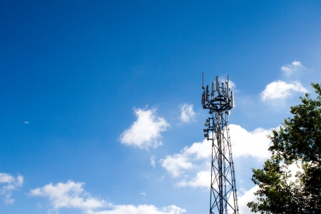 Mobile phone mast with a blue sky behind Stock Photo - 15696536
