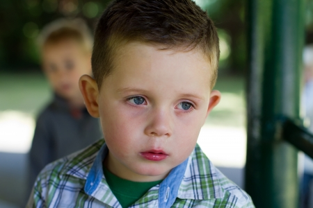sad little boy with a runny nose Stock Photo